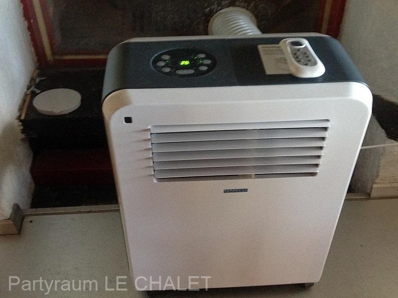 Sommer-Klimagerät-Abluft-in-Cheminee